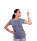 Beautiful young woman pointing and looking left Royalty Free Stock Photos
