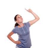 Beautiful young woman pointing and looking up Stock Photography