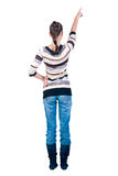 Beautiful young woman pointing . Rear view. Stock Photo