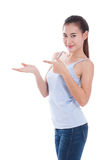 Beautiful young woman pointing and showing open hand palm Stock Photography