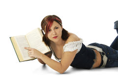 Beautiful Young Woman Pointing to Open Book Royalty Free Stock Images