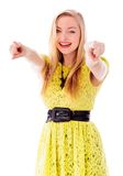 Beautiful young woman pointing towards camera with both hands Royalty Free Stock Photo