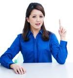 Beautiful young woman pointing upwards Stock Image