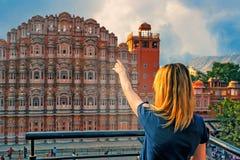 Beautiful girl points to Hawa Mahal. Wanderlust royalty free stock photography