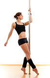 The beautiful young woman and pole Royalty Free Stock Images