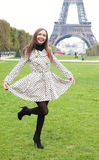 Beautiful young woman in polka dot trench in Paris. Beautiful young woman in polka dot trench near the Eiffel Tower stock image