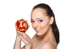 Beautiful young woman with a pomegranate. Stock Photography