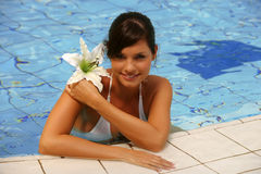 Beautiful young woman at a pool Royalty Free Stock Photo