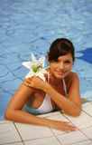 Beautiful young woman at a pool Stock Photos