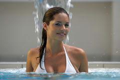 Beautiful young woman at a pool Royalty Free Stock Image
