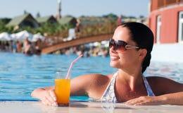 Beautiful young woman at a pool Stock Photos