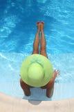Beautiful young woman at a pool Royalty Free Stock Photos