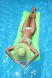 Beautiful young woman at a pool Royalty Free Stock Photography