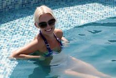 Beautiful young woman at a pool Royalty Free Stock Photo