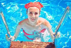 Beautiful young woman in the pool Stock Image