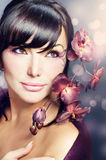 Beautiful Young Woman portrait. Beautiful Healthy Young Woman with Orchid flower royalty free stock images