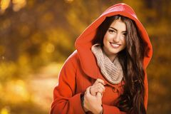 Beautiful young woman. A portrait of a beautiful young woman in an autumn forest. Lifestyle, autumn fashion, beauty stock images
