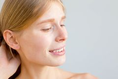 Beautiful young woman. A portrait of a beuatiful young woman with clean skin royalty free stock image