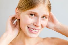 Beautiful young woman. A portrait of a beuatiful young woman with clean skin stock image