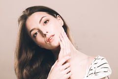 Beautiful young woman portrait cute tender pure smiling  touching her chin by fingers attractive nature background Royalty Free Stock Photos