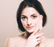Beautiful young woman portrait cute tender pure smiling  touching her face attractive nature background Stock Photos
