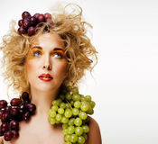 Beautiful young woman portrait excited smile with fantasy art ha. Ir makeup style, fashion girl with creative food fruit orange, grapes, citrus make up, happy Stock Photo