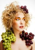 Beautiful young woman portrait excited smile with fantasy art ha. Ir makeup style, fashion girl with creative food fruit orange, grapes, citrus make up, happy Royalty Free Stock Photos
