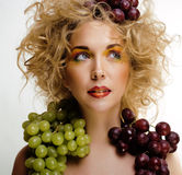 Beautiful young woman portrait excited smile with fantasy art hair makeup style. Fashion girl with creative food fruit orange, grapes, citrus make up, happy Royalty Free Stock Photo