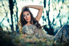 Beautiful young woman portrait in forest Royalty Free Stock Image