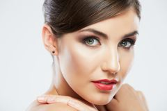 Beautiful young woman portrait  isolated on studio background. Stock Photo