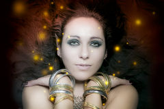 Beautiful young woman portrait with long, mysterious lights floa Stock Images