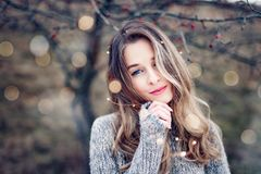 Beautiful young woman portrait in nature stock image