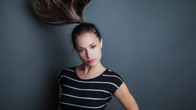 Young pretty woman portrait with ponytail in motion studio shot Stock Image
