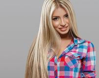 Beautiful young woman portrait posing attractive with amazing long blonde hair Stock Image