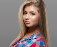 Beautiful young woman portrait posing attractive with amazing long blonde hair Royalty Free Stock Photo