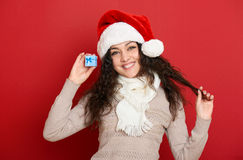 Beautiful young woman portrait  in santa helper hat posing on red Stock Photos