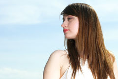 Beautiful young woman portrait sky Stock Photo