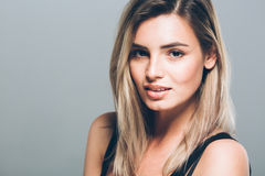 Beautiful young woman portrait smiling posing attractive blond Stock Image