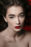 Beautiful young woman. Portrait of a beautiful young woman with windswept hair and red lipstick Stock Photo