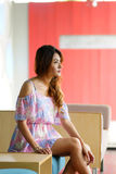 Beautiful young woman posing alone in the cafe Royalty Free Stock Photography