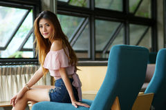 Beautiful young woman posing alone in the cafe Royalty Free Stock Image