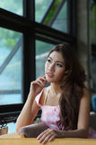 Beautiful young woman posing alone in the cafe Royalty Free Stock Photo