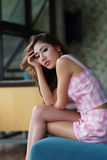 Beautiful young woman posing alone in the cafe Stock Photo