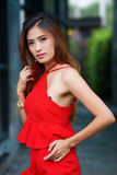 Beautiful young woman posing alone at the outdoor cafe. Model is Thai Ethnicity Stock Images