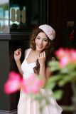 Beautiful young woman posing alone at the outdoor cafe. Model is Thai Ethnicity Royalty Free Stock Images