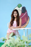 Beautiful young woman posing alone at the outdoor cafe. Model is Thai Ethnicity Stock Image