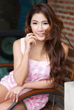 Beautiful young woman posing alone at the outdoor cafe. Model is Thai Ethnicity Royalty Free Stock Photo