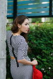 Beautiful young woman posing alone at the outdoor cafe. Model is Thai Ethnicity Royalty Free Stock Photos