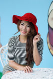 Beautiful young woman posing alone at the outdoor cafe. Model is Thai Ethnicity Stock Photo