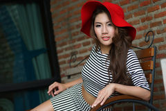 Beautiful young woman posing alone at the outdoor cafe Stock Image